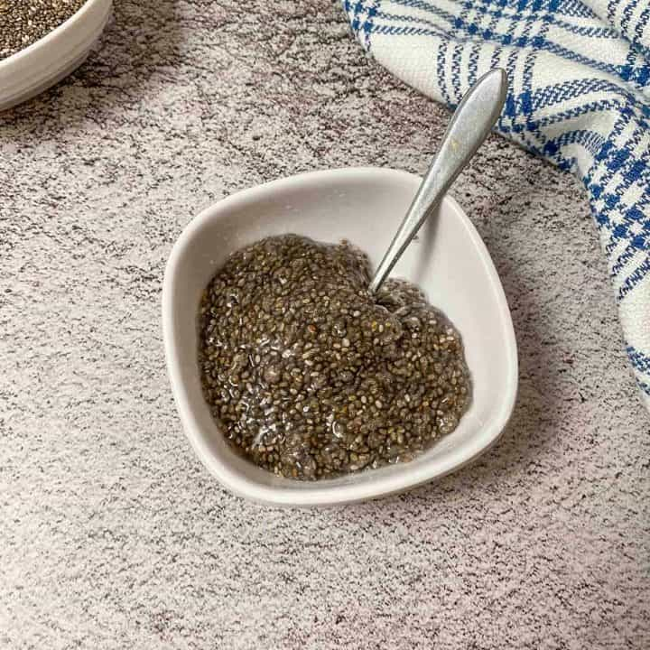 chia seeds and water in small white bowl