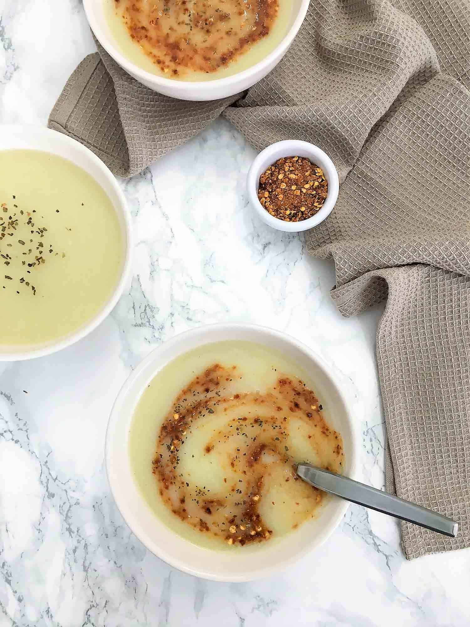 bowl of soup with chili flakes on top