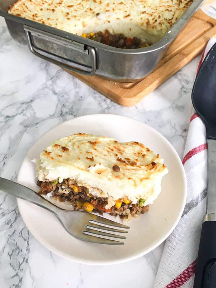 slice of shepherd's pie in plate with fork