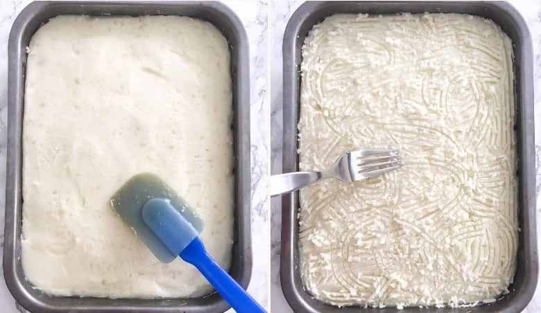 smoothing out mashed potatoes in baking dish