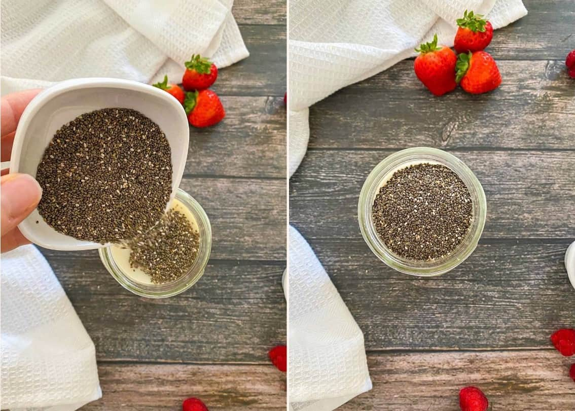 Hand pouring chia seeds into glass jar filled with milk.