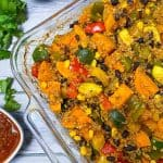 glass dish with cooked sweet potato, peppers, zucchini, corn, black beans and quinoa