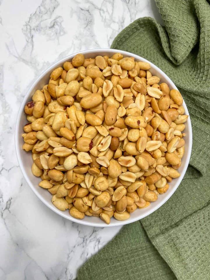 white bowl filled with roasted peanuts