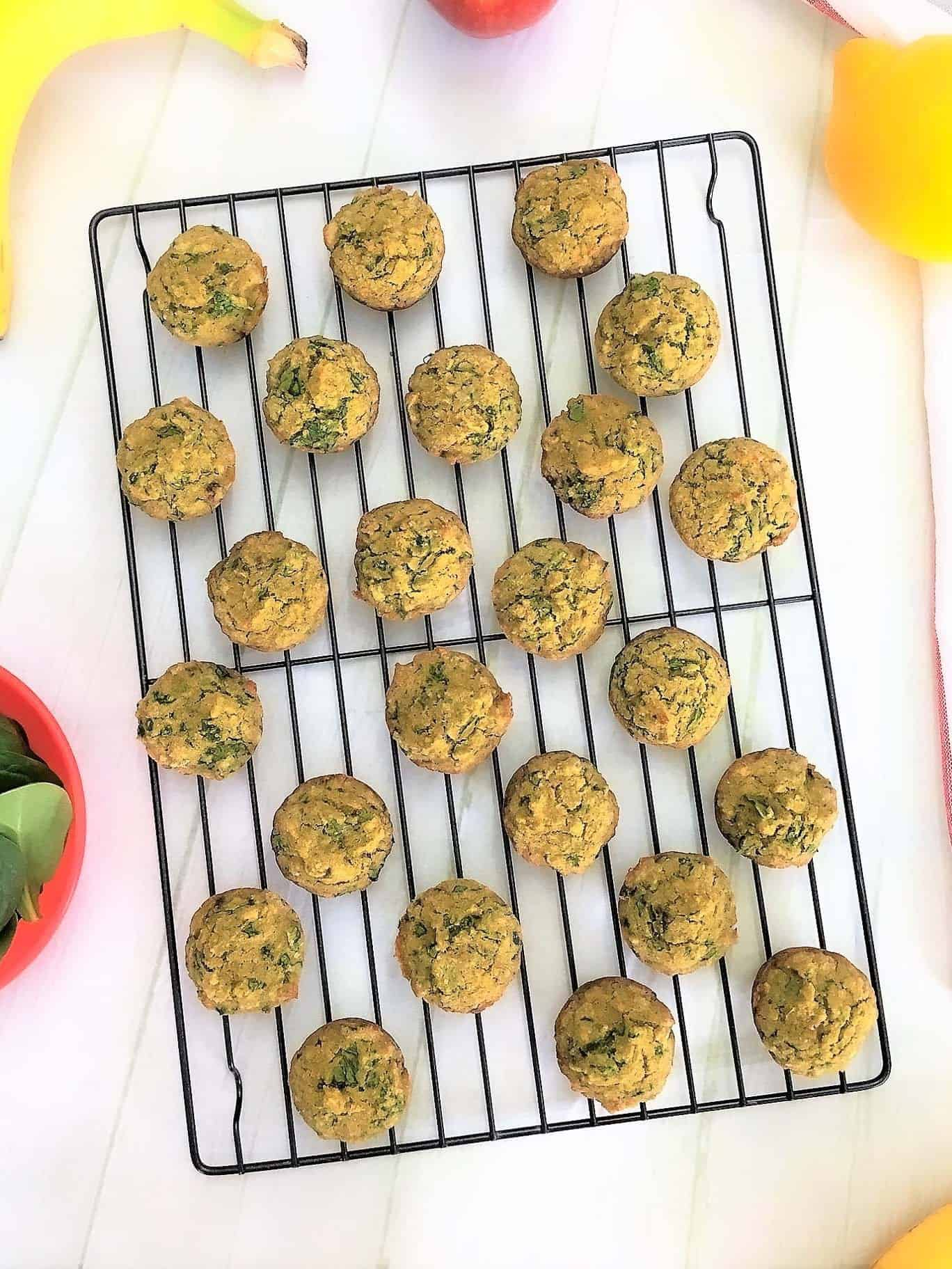 spinach banana muffins on cooling rack