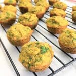 spinach banana muffins on cooling rack on a side angle