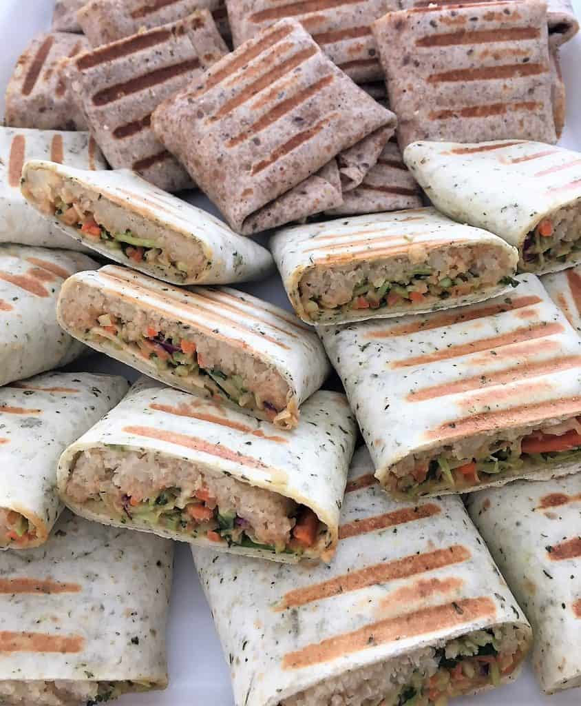 vegan wraps cut in half on platter