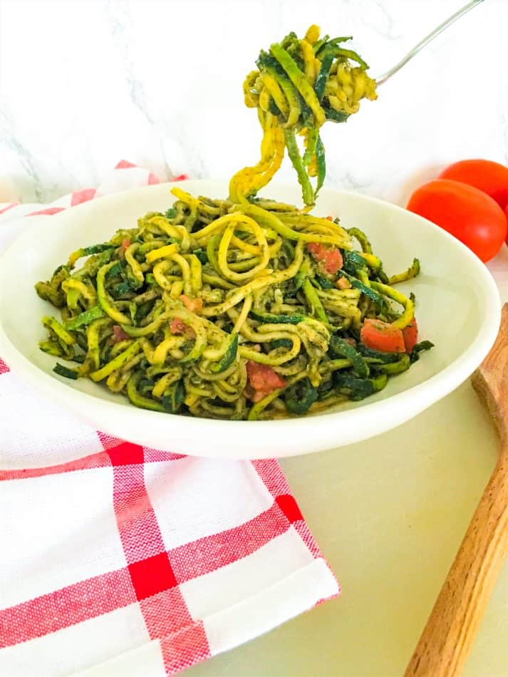 fork holding up a bite of pesto zucchini noodles
