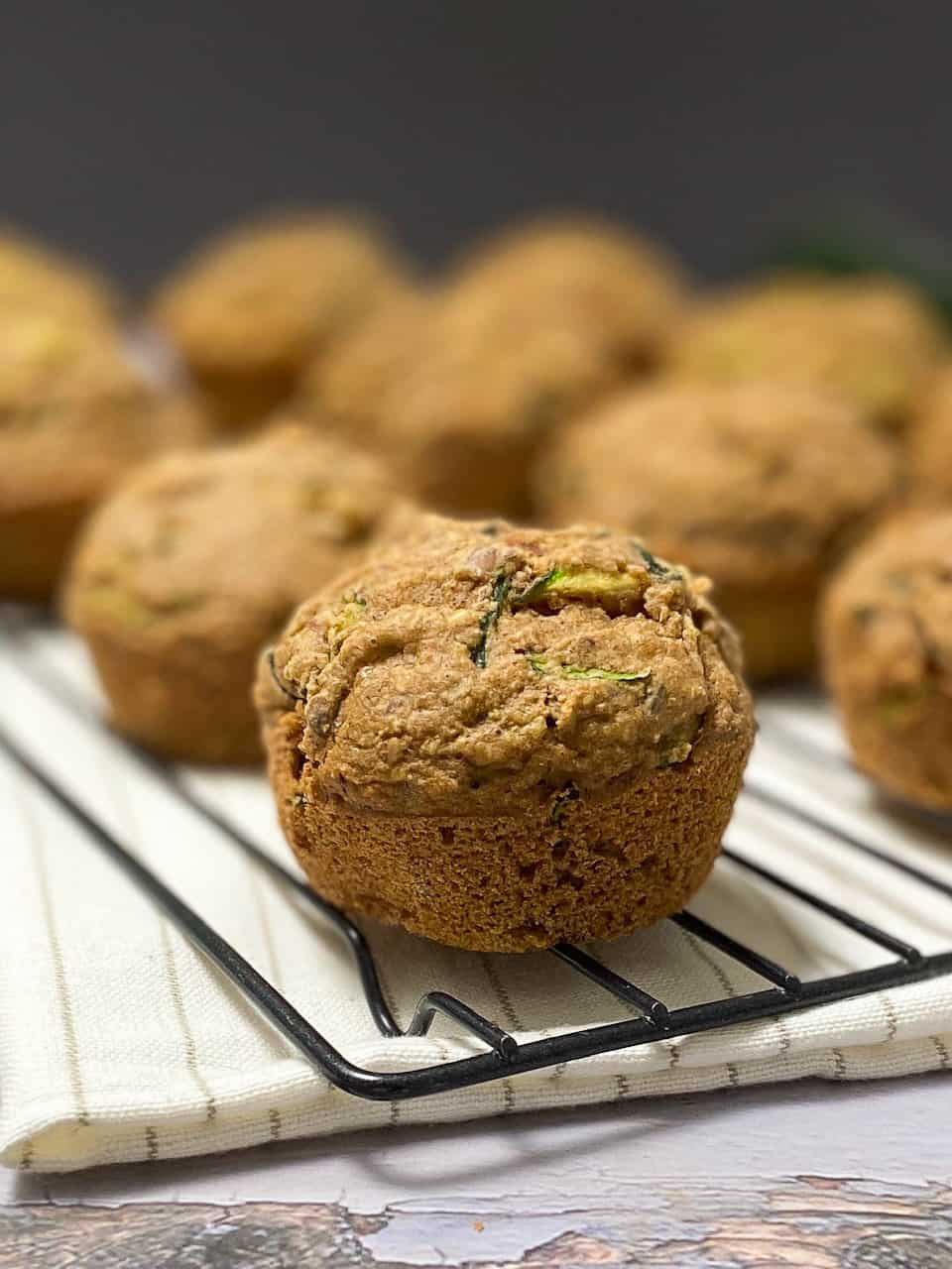 zucchini muffins on cooling wire rack