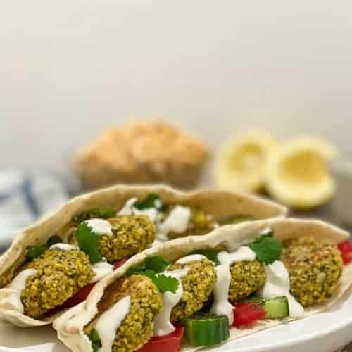 pita stuffed with falafel, tomato, cucumber and tahini