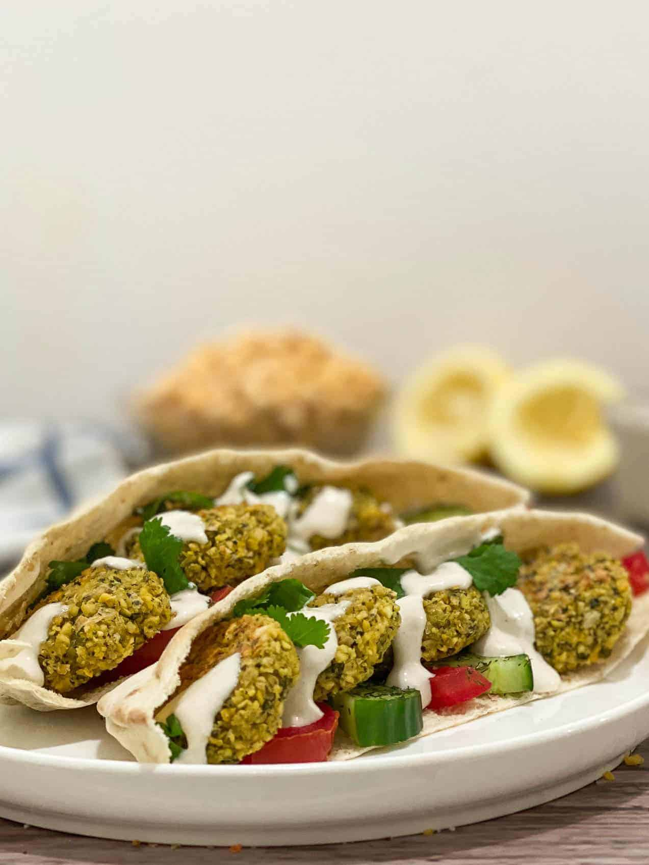 pita stuffed with falafel, tomato, cucumber and tahini