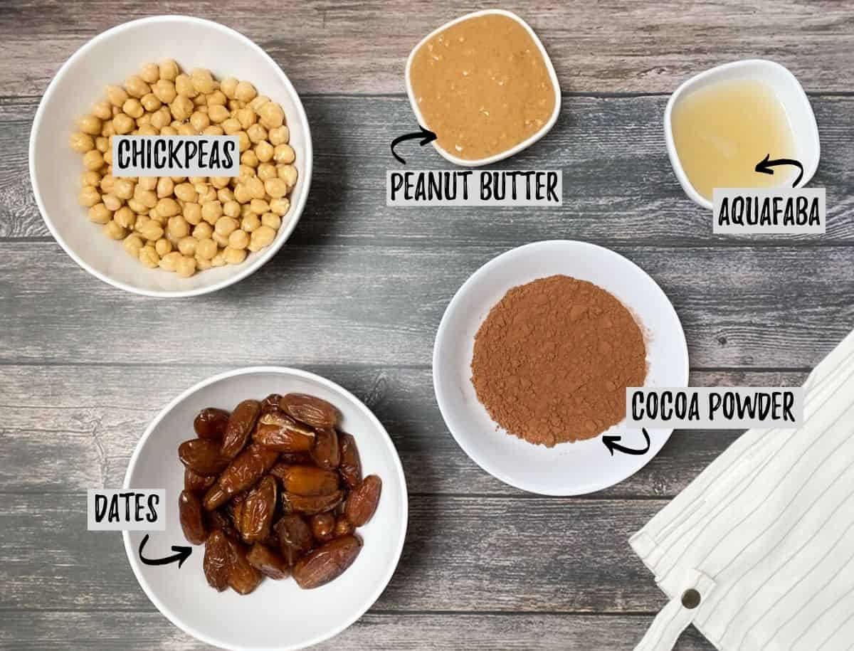 ingredients for chickpea brownies: chickpeas, dates, cocoa powder, peanut butter, aquafaba