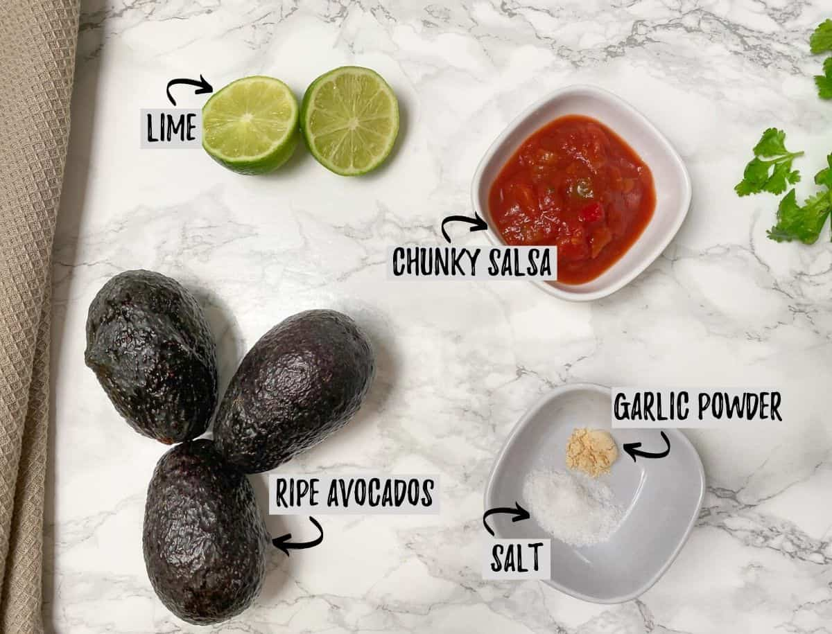 avocados, lime, salsa, and seasoning in bowls