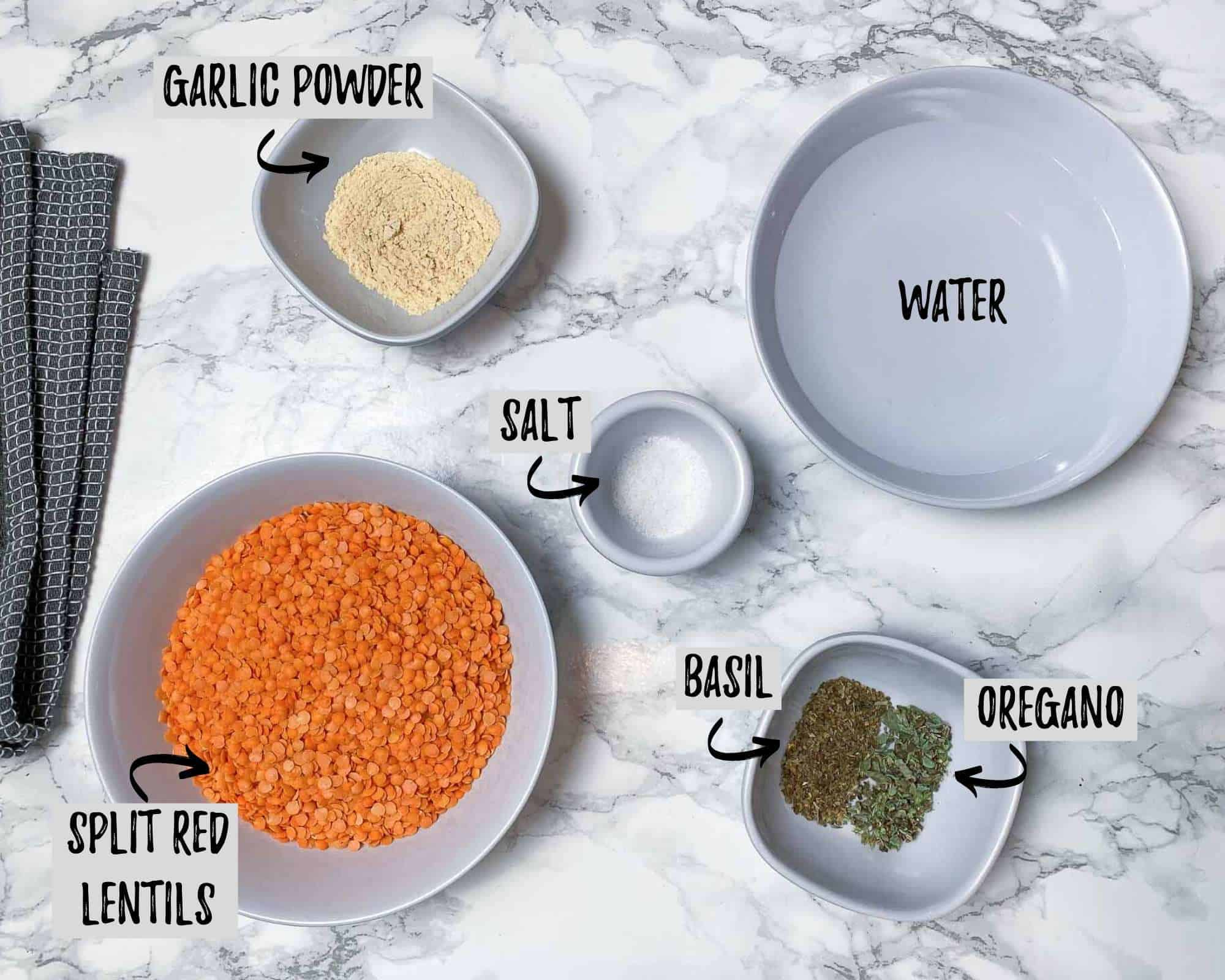 ingredients needed to make lentil pizza crust on marble counter