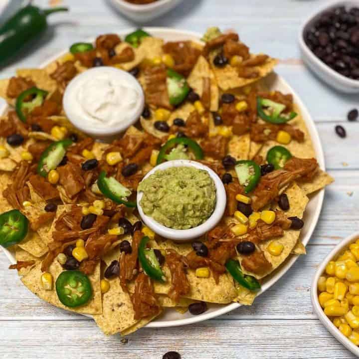 platter of tortilla chips with jackfrui, jalapeno and corn on top