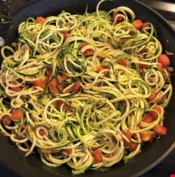 Zucchini noodles cooking in skillet