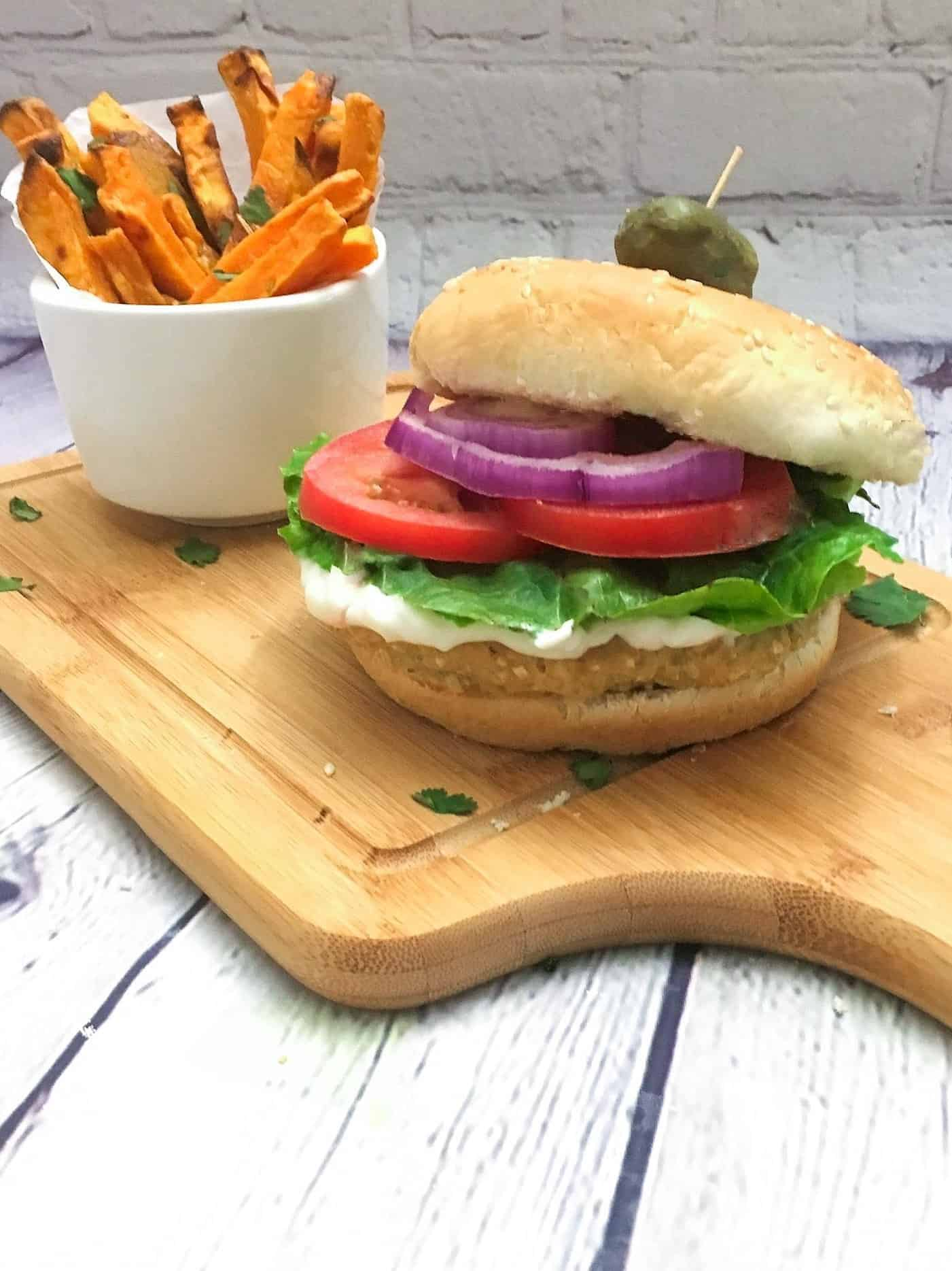 vegan chicken burger with top bun sliding down