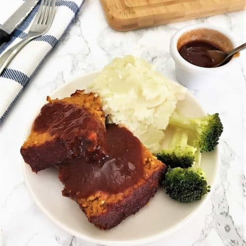 plate of sliced meatloaf, mashed potatoes and broccoli