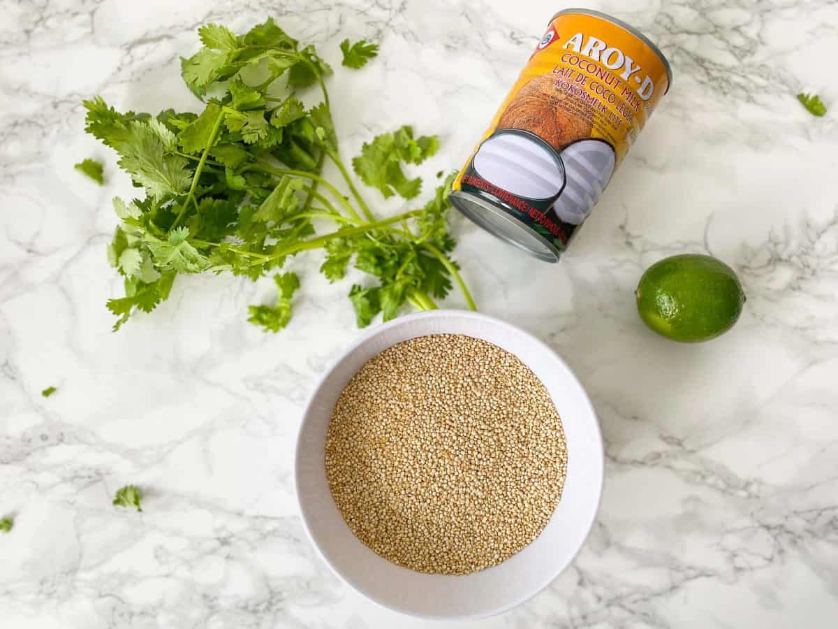 Ingredients needed to make coconut quinoa on marble counter.