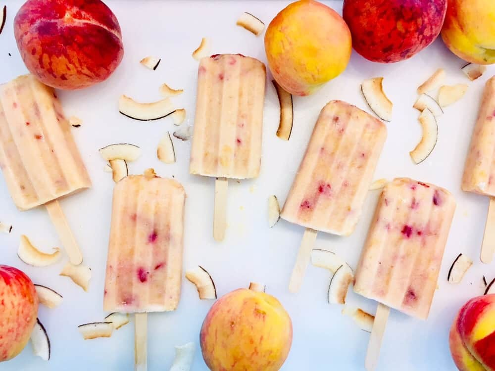 peach popsicles with coconut smiles