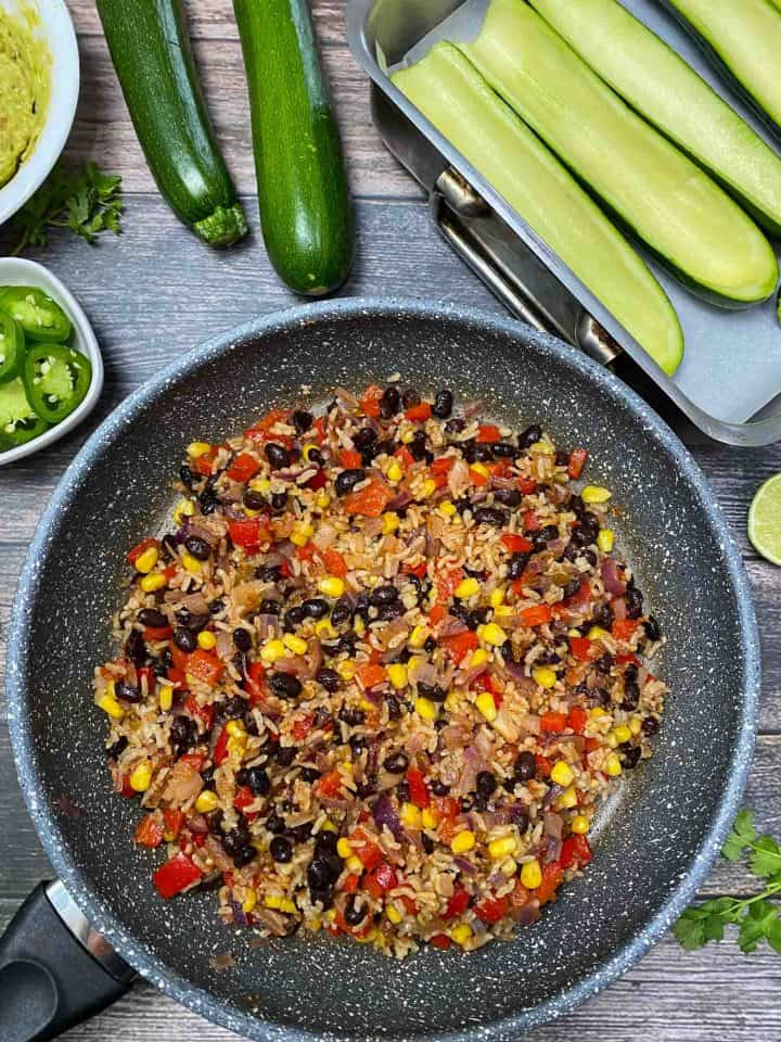 skillet of bean, rice, and corn stuffing
