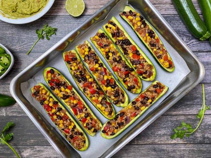 stuffed zucchini burrito boats in baking tray