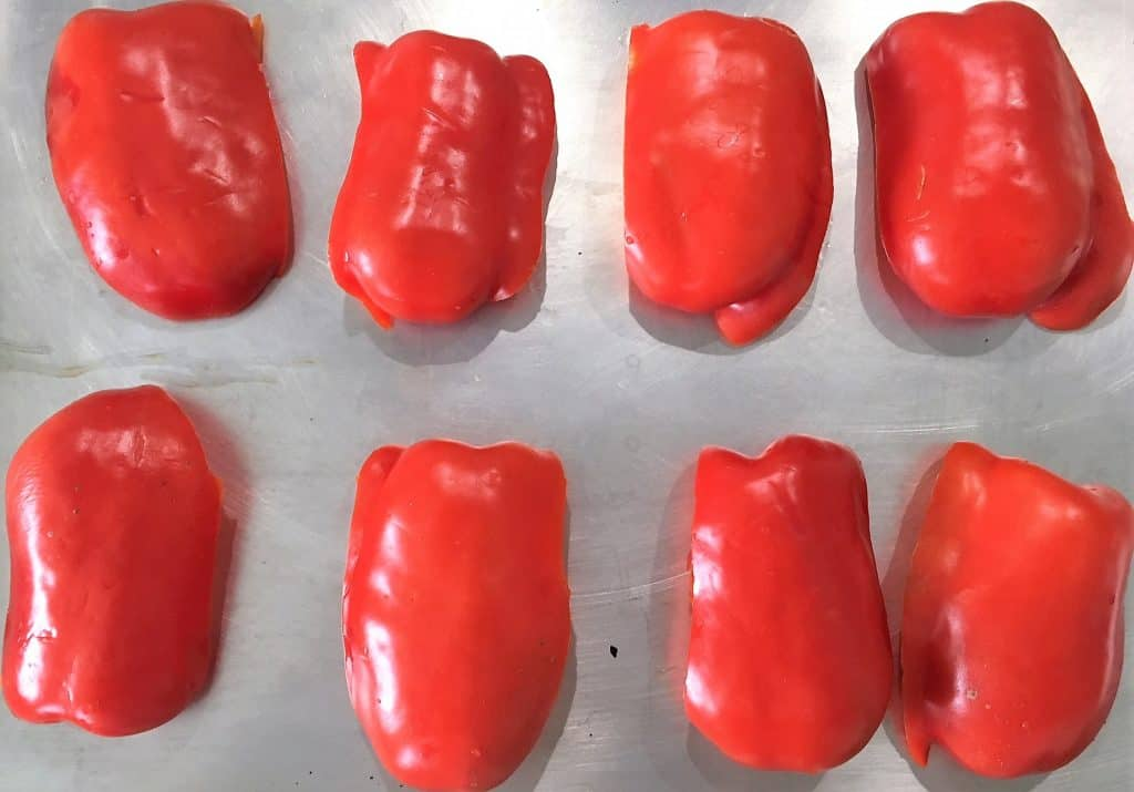 red peppers face down in tray