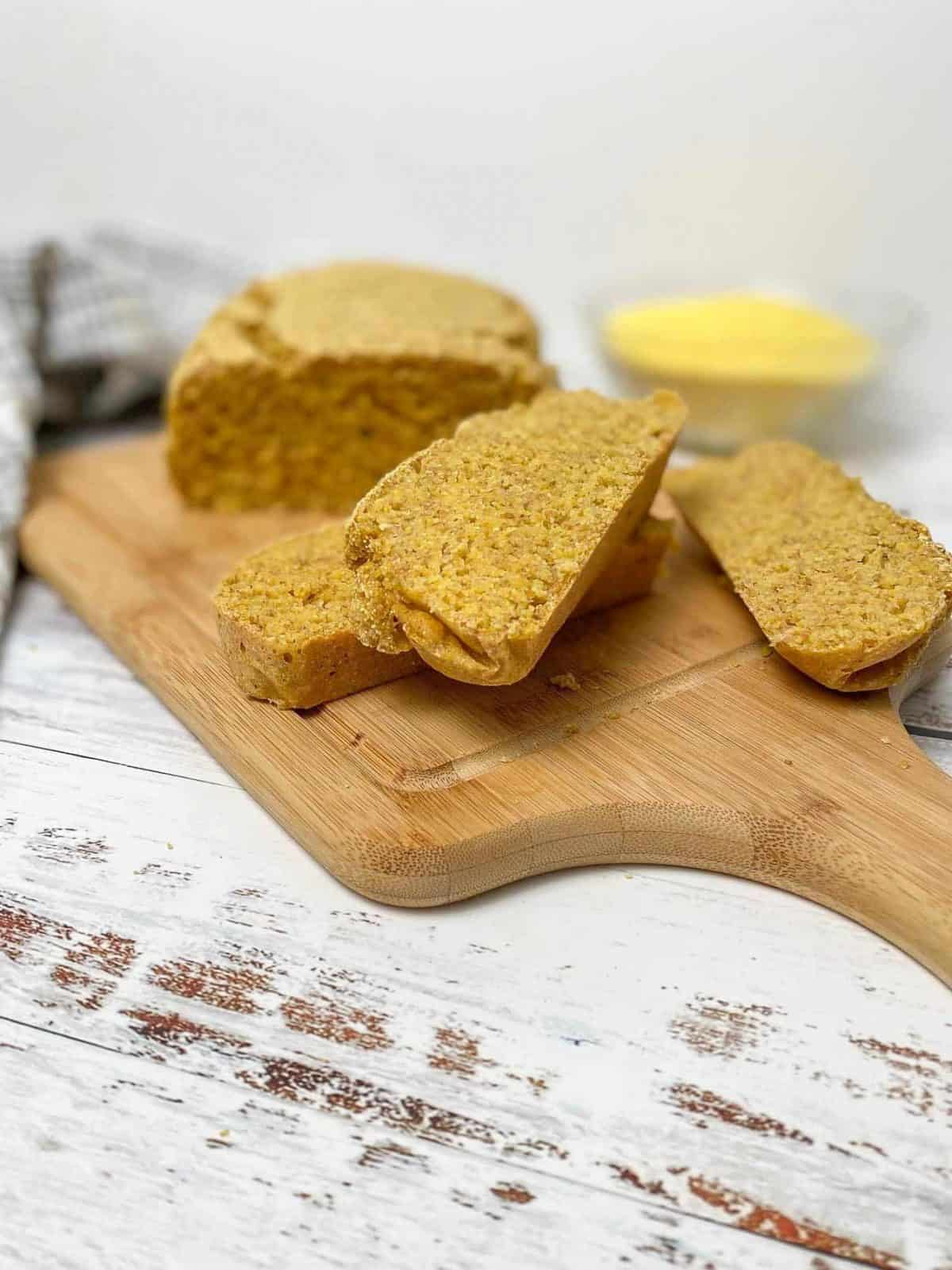 three slices of cornbread on cutting board