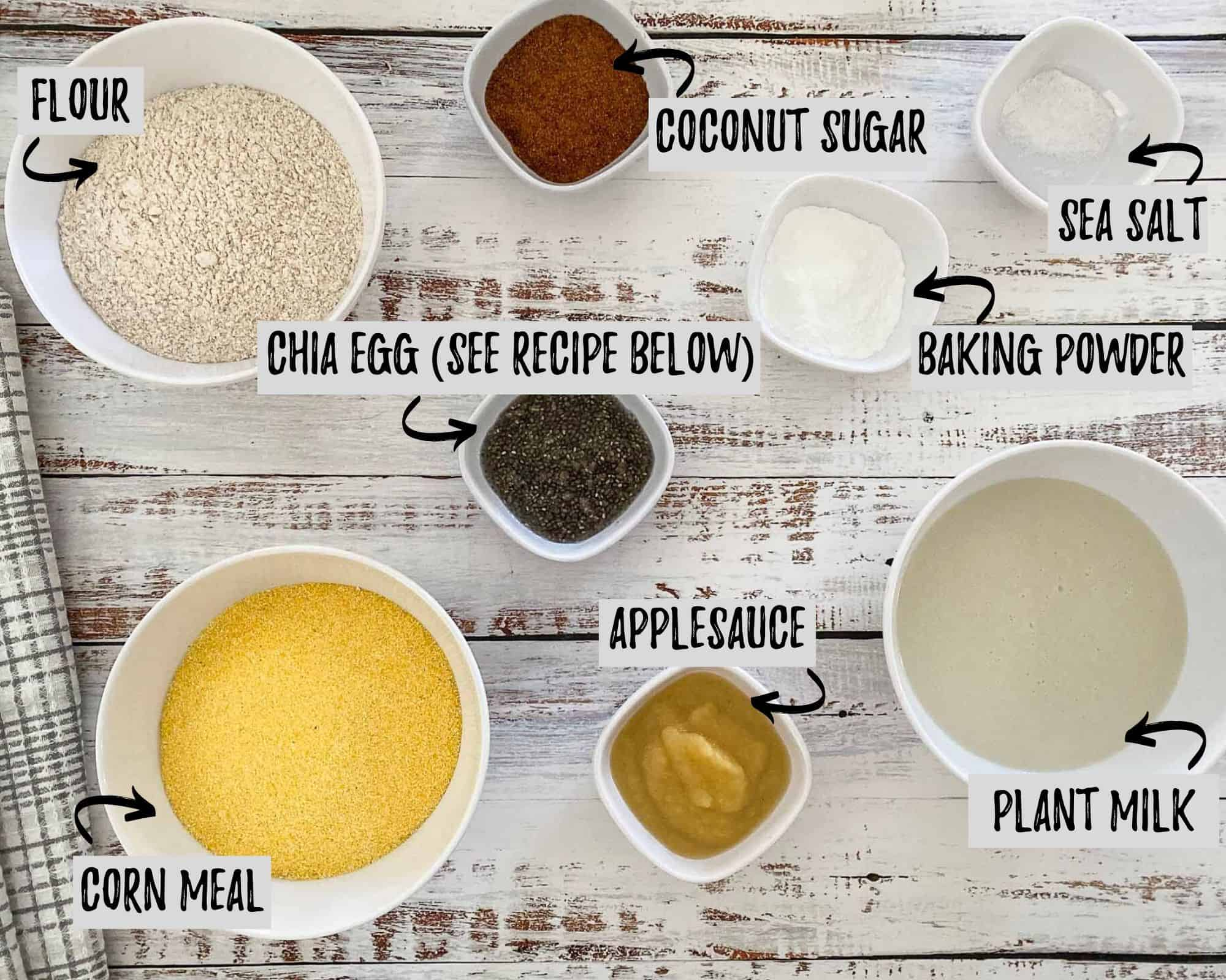 corn meal, flour, chia seeds, brown sugar, applesauce, baking powder and milk in small bowls