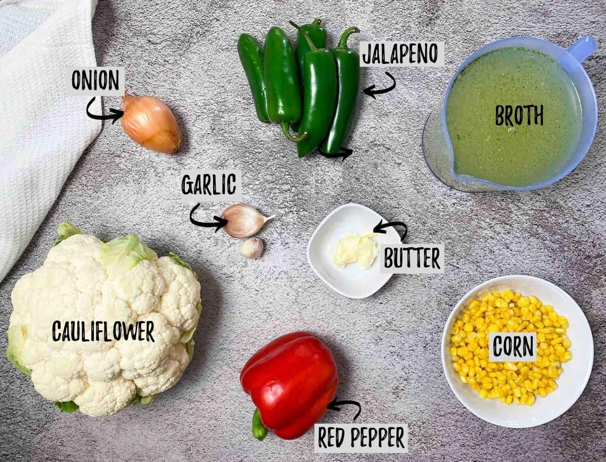 ingredients to make vegan jalapeno popper soup: cauliflower, red pepper, jalapenos, corn, broth, onion, garlic, butter