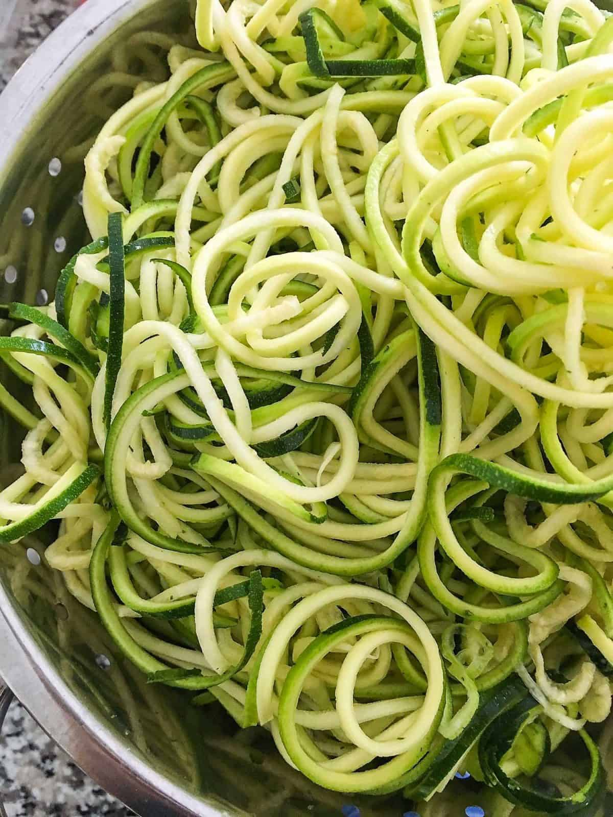 spiralized zucchini noodles in colander