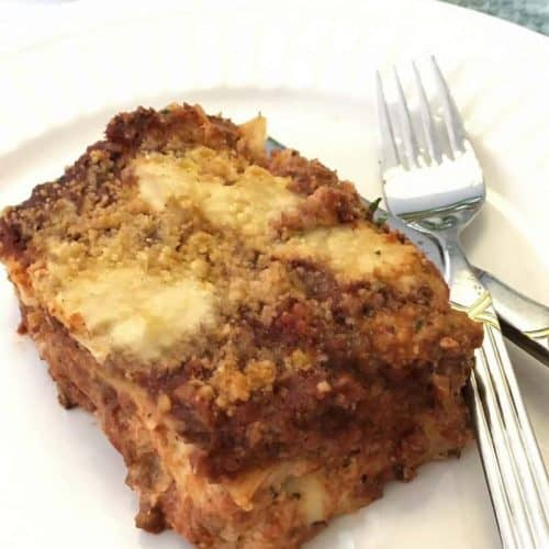 Gluten Free Three Cheese Vegan Lasagna sliced on plate with fork and knife