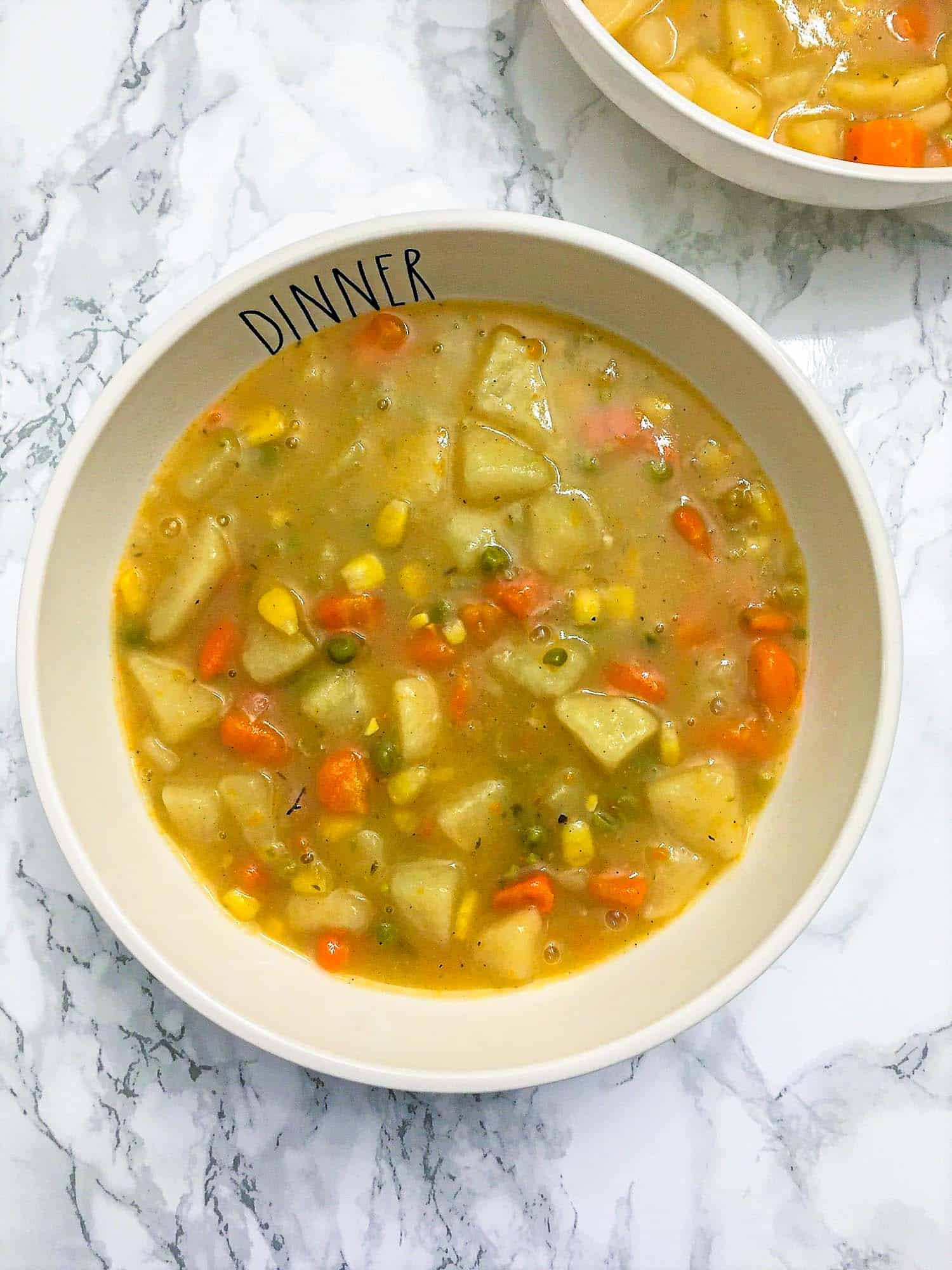 vegetable pot pie stew in white bowl