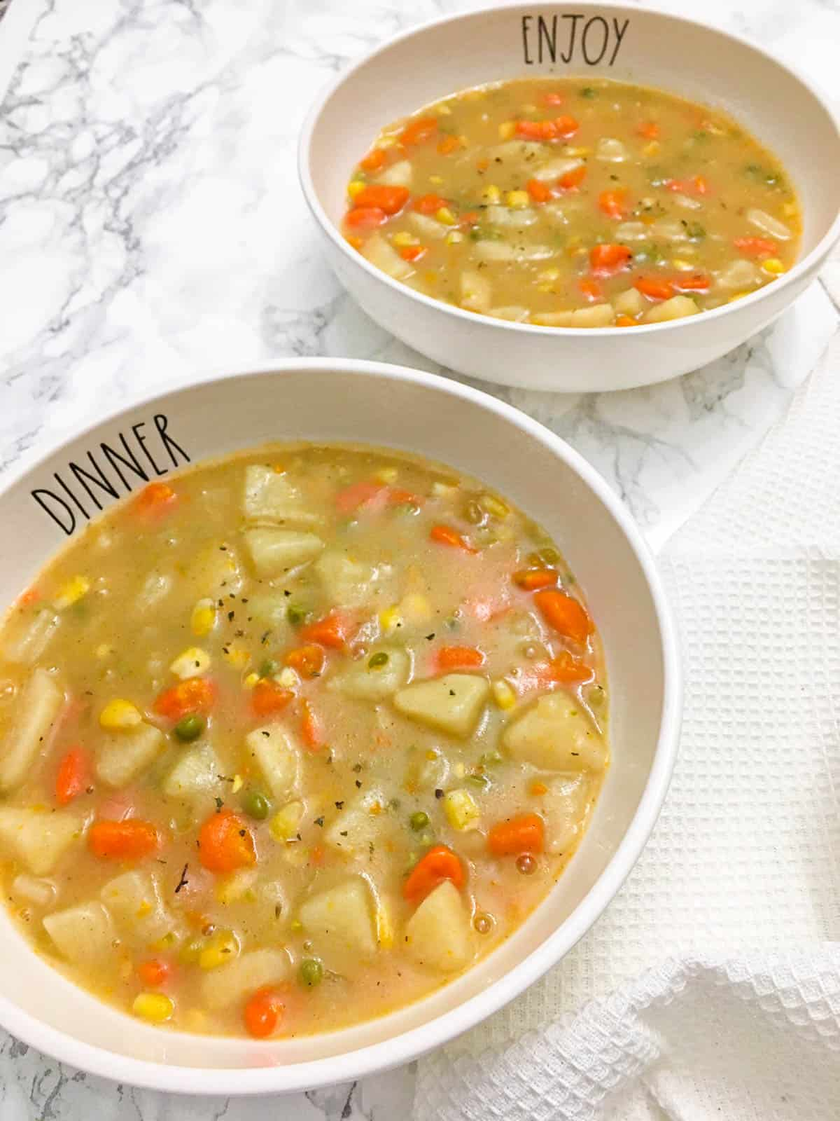 Two bowls of vegetable pot pie stew.