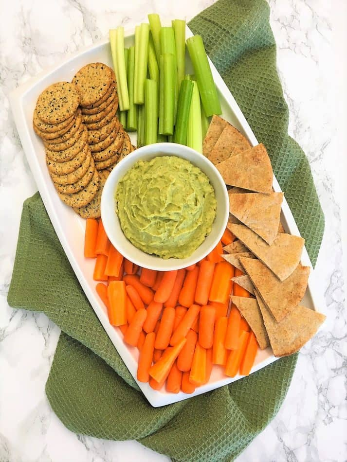 White Bean Dip on tray with crackers, veggies and pita