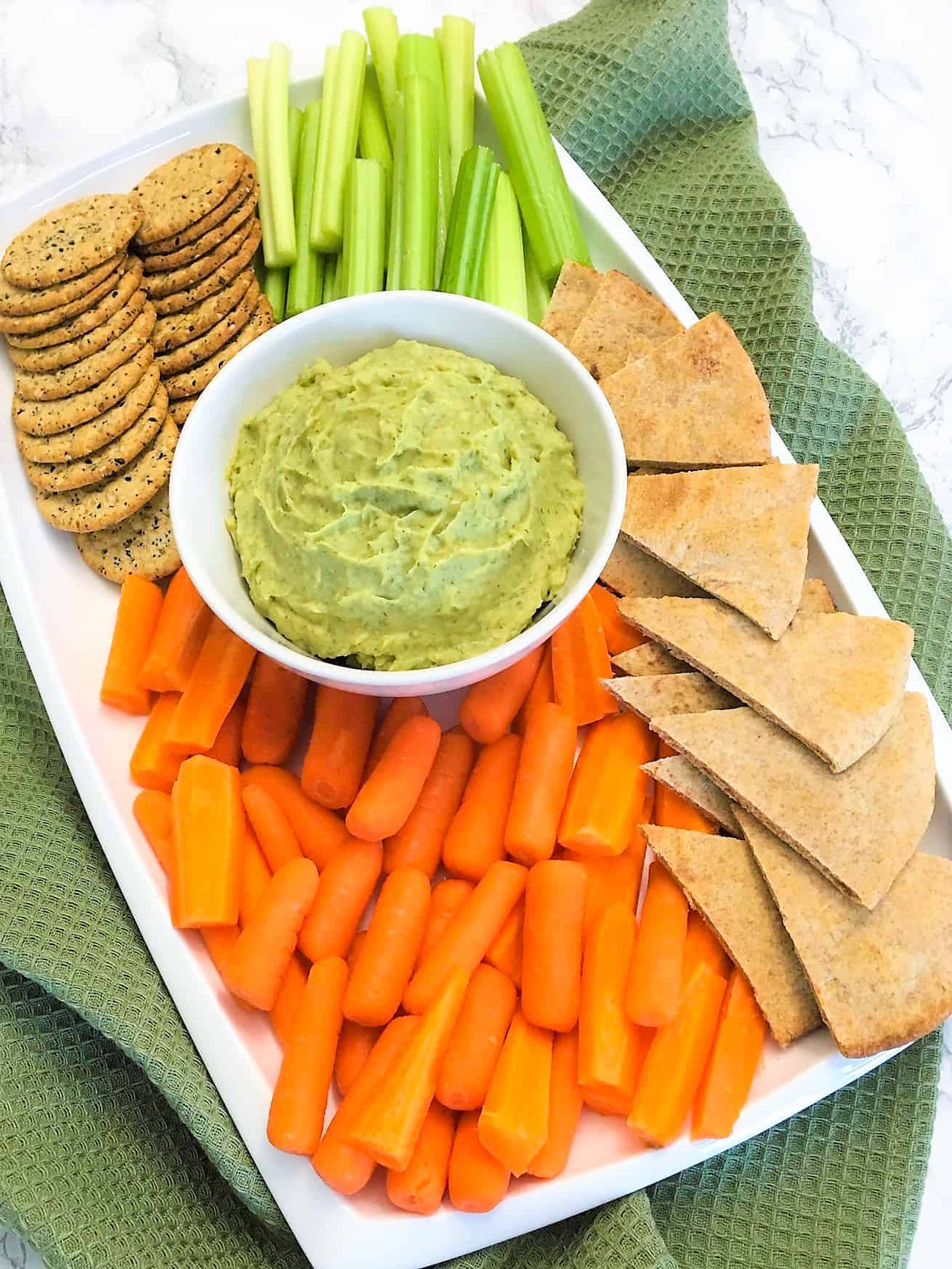 White Bean Dip on tray of veggies and crackers