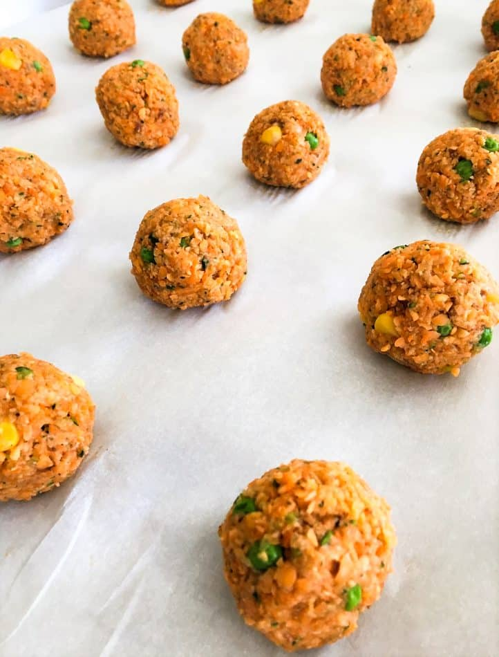 Lentil Veggie Nuggets rolled into balls on baking sheet