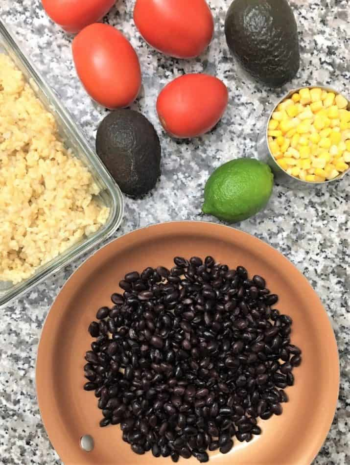 Taco Buddha Bowl Prep-tomatoes, avocados, black beans, corn, brown rice, lime