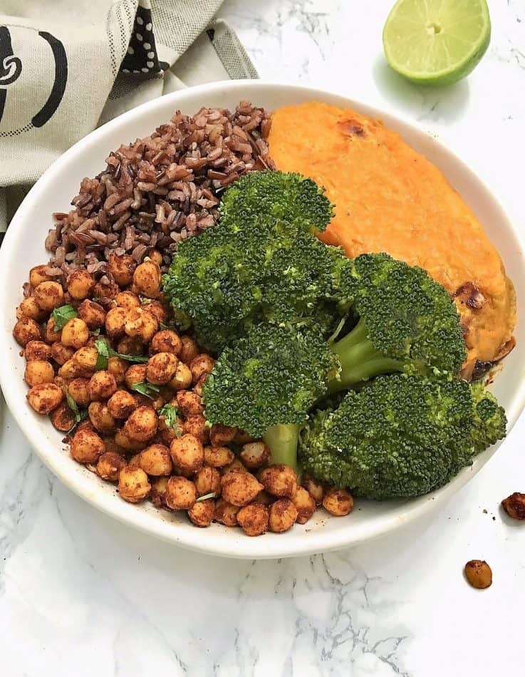 chili lime chickpea buddha bowl with broccoli, roasted sweet potato, wild rice blend and broccoli