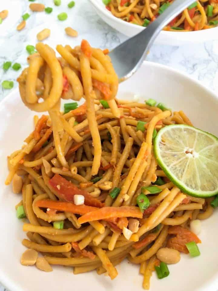 Thai Peanut Noodles with fork grabbing a bite