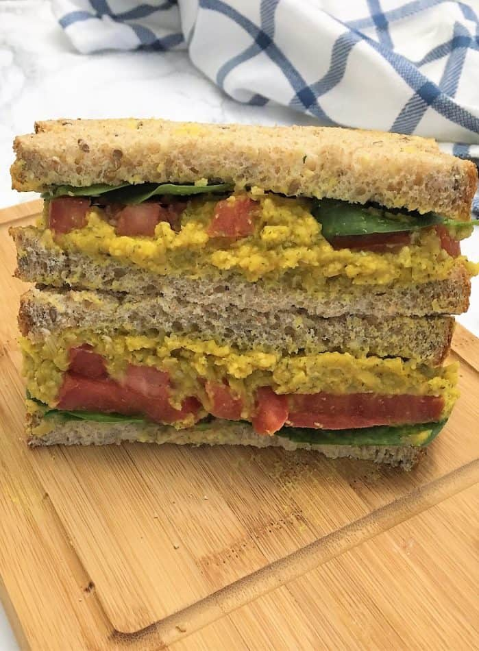 Chickpea Salad Sandwich cut in half and stacked on top of each other