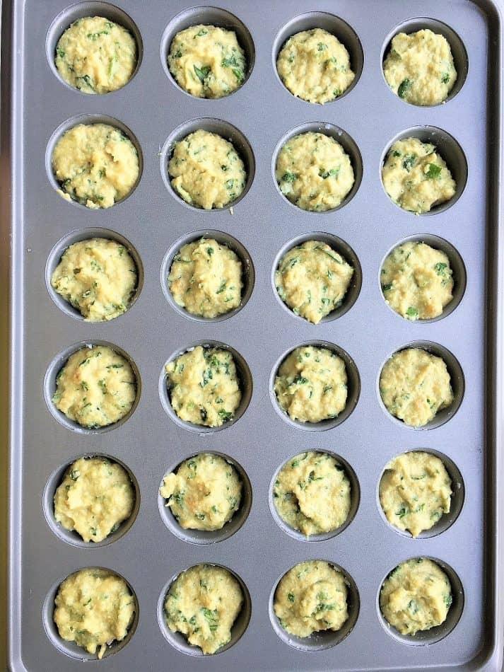 banana spinach mufin bites batter in mini muffin pan before baking