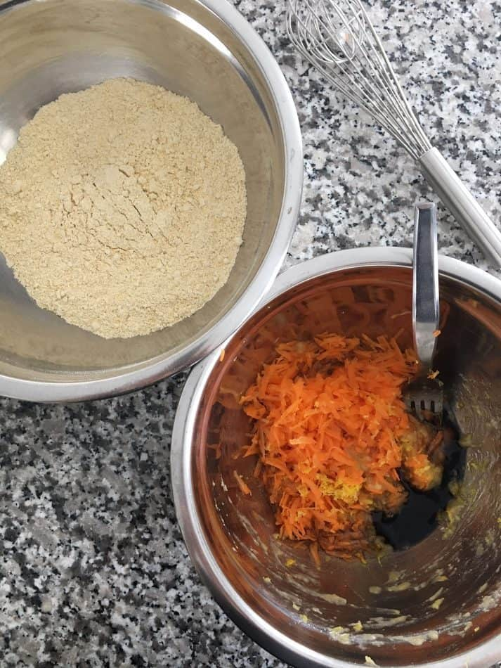 bowl of dry ingredients and bowl of wet ingredients for carrot muffins