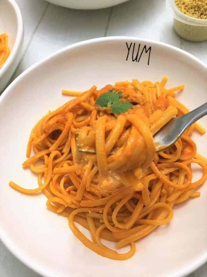 fork full of roasted red pepper pasta