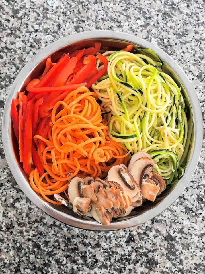 spiralized raw veggie noodles in bowl