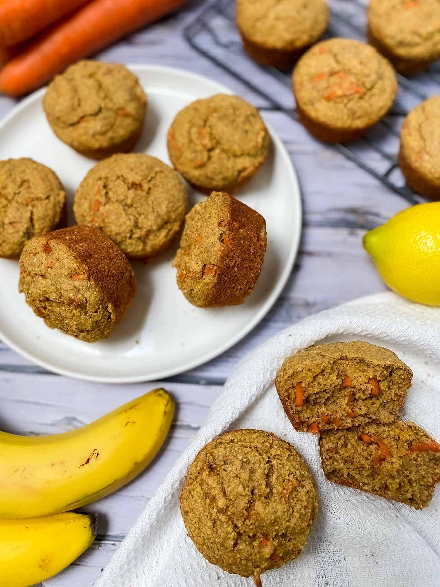 plate of banana carrot muffins with banana and lemon beside it