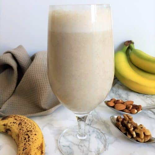 smoothie with bananas, walnuts, almonds in background