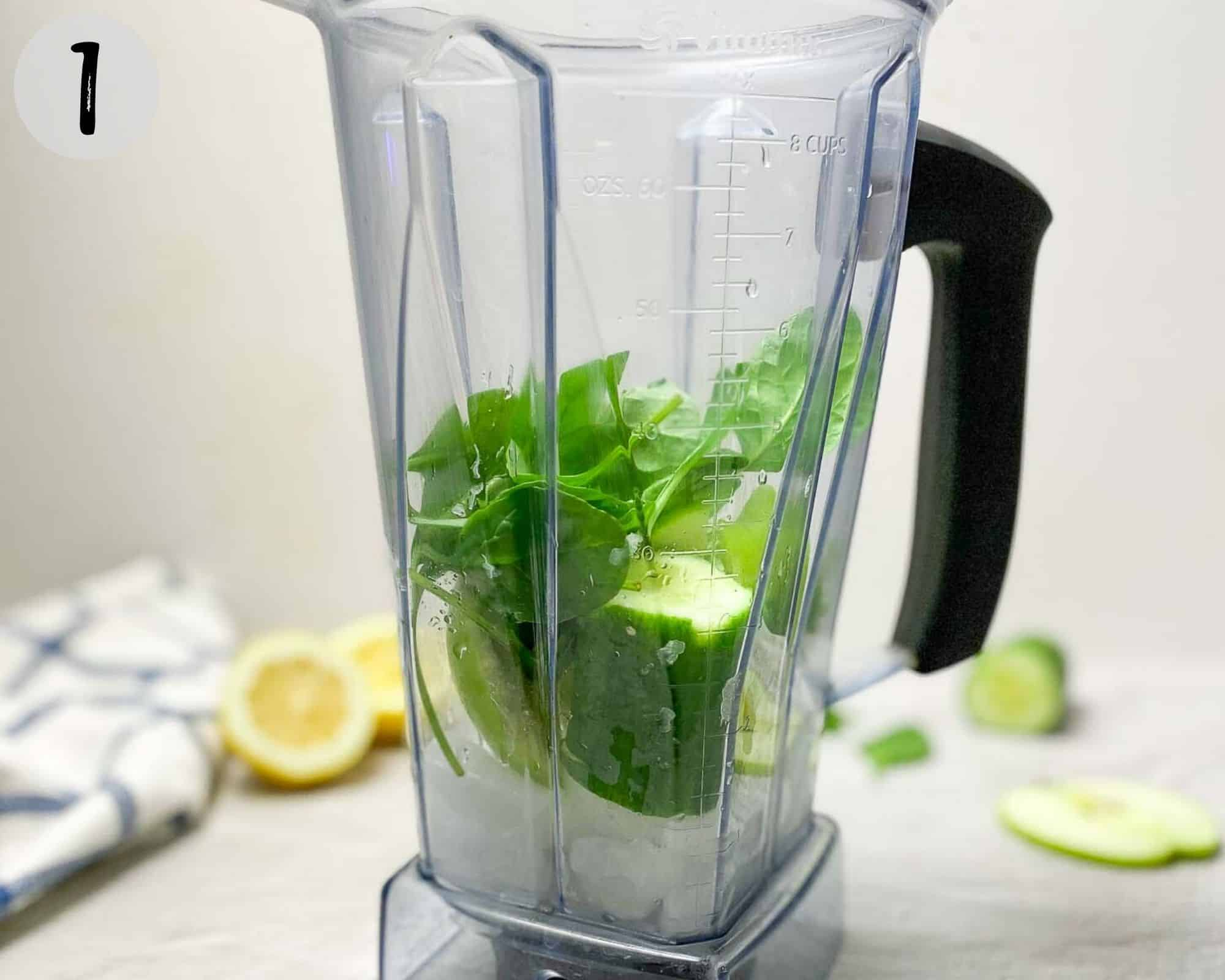 cucumber, spinach, apple and ice cubes in blender