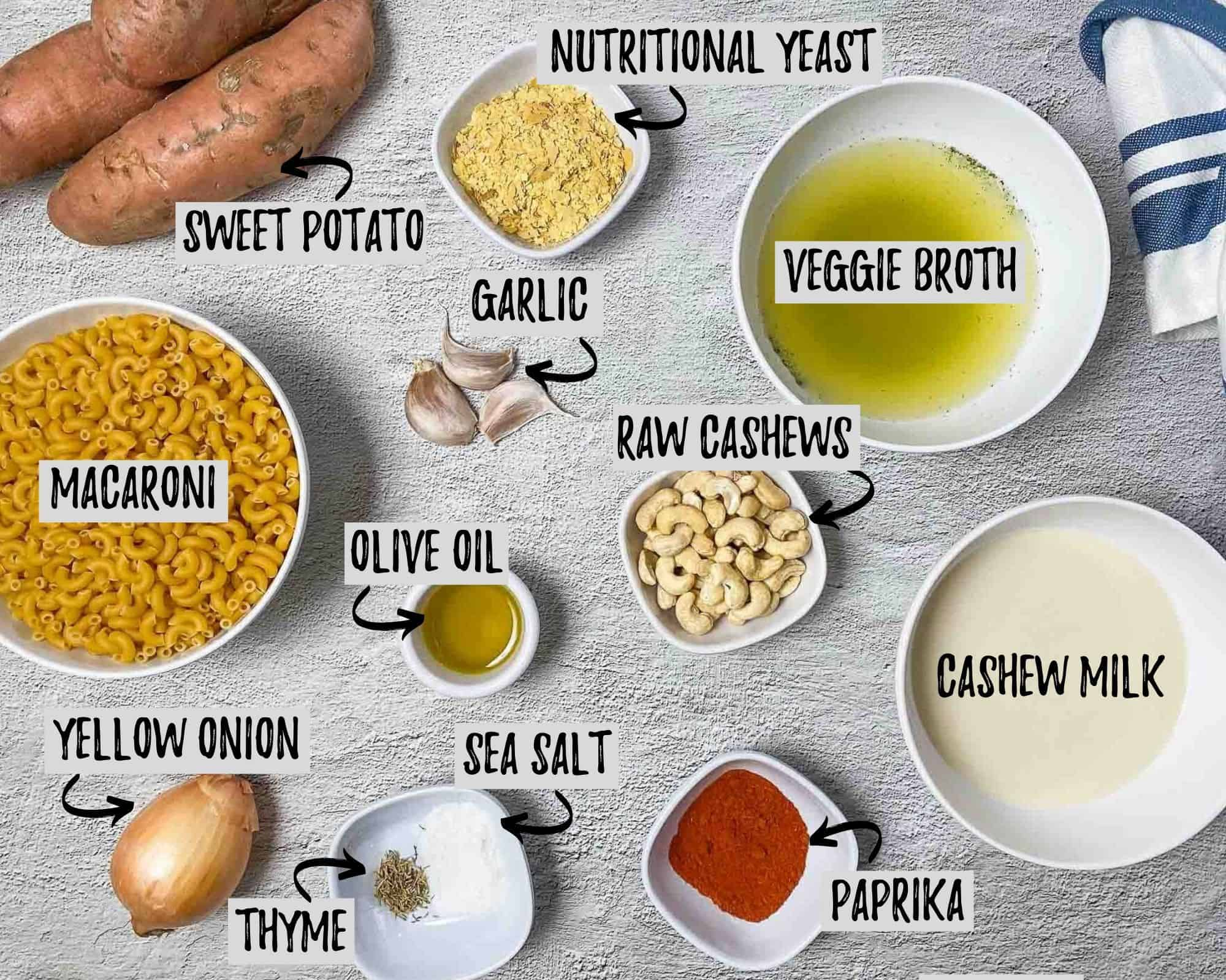 ingredients to make sweet potato mac and cheese: broth, pasta, sweet potatoes, paprika, milk, cashews, onion, garlic, salt, nutritional yeast, thyme