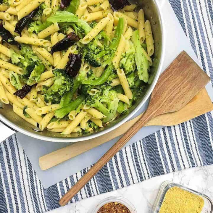 pasta with hot peppers and broccoli in skillet.