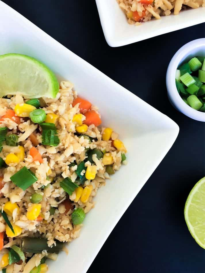 Cauliflower fried rice close up with lime wedge